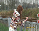 Thumbnail handcuffed to a fence