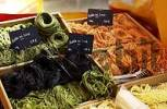 Thumbnail Multicolored noodles at market stand