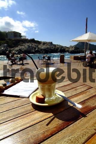 Cafe con leche, Latte Macciato on a wooden desk, Cala Rajada, Mallorca, Spain