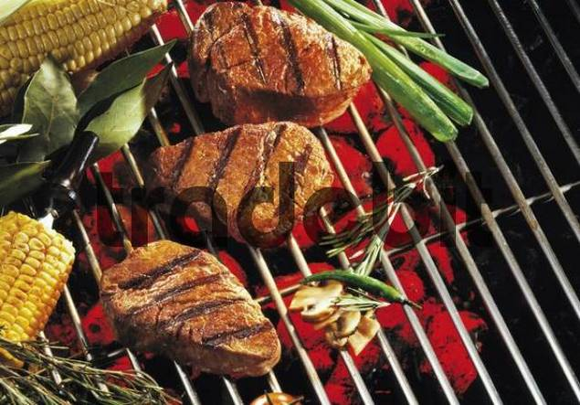 Beefsteaks, steak on a barbecue